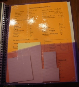 The last pocket, which is where I keep a formula chart from Geometry and my sticky notes of various sizes.